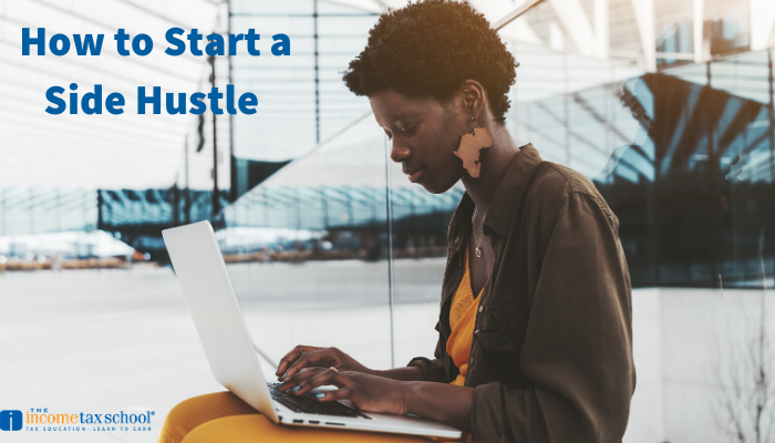 Black woman on computer starting a side hustle